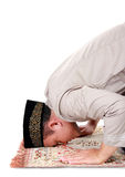 Man muslim doing prayer. Isolated over white background stock images