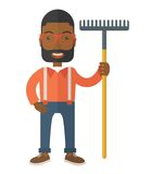Man with a mustache holding a rake Stock Photography