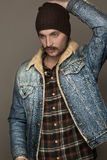 A man with a mustache in jeans jacket. Blue eyes Stock Image