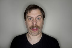 Man with a mustache making a funny face. Royalty Free Stock Photos