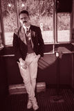 Man with mustache in suit posing in a wagon train or tram Stock Photography