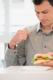 Man with mustard on his shirt Stock Photography