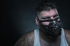 Man in muzzle Royalty Free Stock Photography