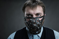 Man in muzzle Stock Photo