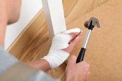 Man nailing with a hammer Stock Photos