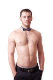 Man with naked torso and a bow tie Royalty Free Stock Photos