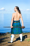 Man with naked torso in kilt Royalty Free Stock Photography