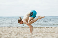 Man with naked torso practicing yoga outdoors royalty free stock photography