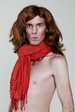 Man with a naked torso in a red scarf Stock Image