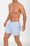Man with naked torso in underwear. On neutral background Stock Photos