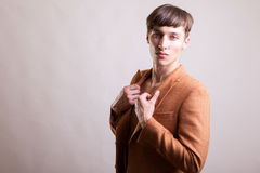 Man in naked torso wearing a fashion jaket. On gray background in studio photo Stock Images