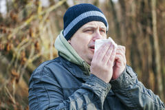 Man with napkin going to sneeze Royalty Free Stock Photos
