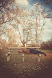 Man Napping on a Bench Stock Photo