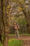 Man in nature with backpack - Portrait Stock Photo