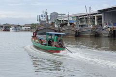 A man navigates his boat of passengers go to Kawthaung township Stock Photography