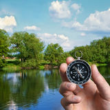 Man navigating the countryside with a compass Stock Photo