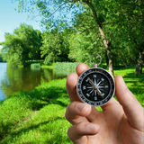 Man navigating the countryside with a compass Royalty Free Stock Photos