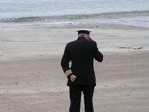 Man in Navy Uniform. A man in a british merchant navy uniform talking on his mobile phone Royalty Free Stock Images