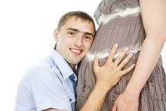 Man near the abdomen of pregnant Stock Photos