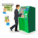 Man near ATM holding credit card and its usage sign Stock Images