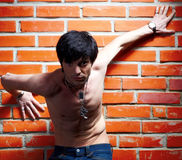 Man near brick wall Stock Photography