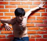 Man near brick wall Stock Photography
