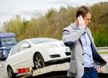 Man near broken car on a highway Royalty Free Stock Photography