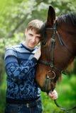 Man near a brown horse Stock Photography