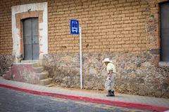 Man near a bus stop sign, Mexico City, Mexico Royalty Free Stock Photos