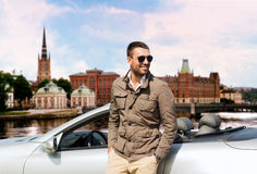 Man near cabriolet car over city of stockholm Royalty Free Stock Images