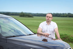 Man  near the car on the road Stock Image