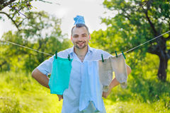 Man near the children's clothing hanging on a rope Royalty Free Stock Photography