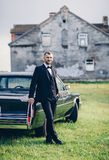 Man near classic car. Handsome man in suit near classic car Royalty Free Stock Photography