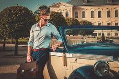 Man near classic convertible Stock Photos