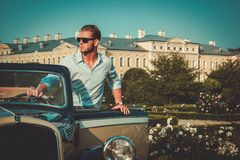 Man near classic convertible Royalty Free Stock Images
