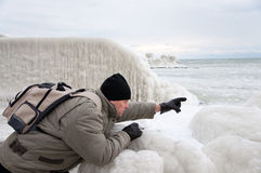 Man near frozen sea coast pointing Royalty Free Stock Images