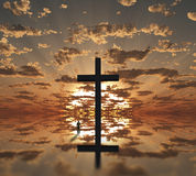 Man near giant cross with sunrise. Background Stock Photo