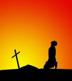 Man near the grave at sunset Royalty Free Stock Photography