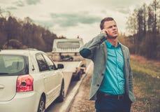 Man near his broken car Stock Image