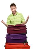 Man near the pile of suitcases. Isolated on white. Concept of traveling and cool vacations Stock Photos