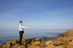 Man near sea with laptop Stock Photography