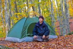 Man  near a tent in a forest Royalty Free Stock Photos