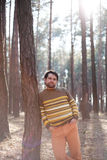 Man near the tree in a sunny forest Royalty Free Stock Photo