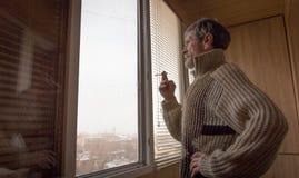 Man near a window. Stock Photos