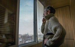 Man near a window. Stock Photography