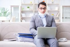 The man in neck brace cervical collar working from home teleworking. Man in neck brace cervical collar working from home teleworking royalty free stock photos