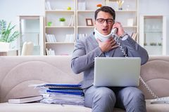 The man in neck brace cervical collar working from home teleworking. Man in neck brace cervical collar working from home teleworking stock image