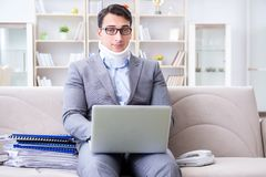 The man in neck brace cervical collar working from home teleworking. Man in neck brace cervical collar working from home teleworking stock photography
