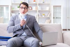 The man in neck brace cervical collar working from home teleworking. Man in neck brace cervical collar working from home teleworking stock images