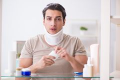 The man with neck brace after whiplash injury. Man with neck brace after whiplash injury Royalty Free Stock Images